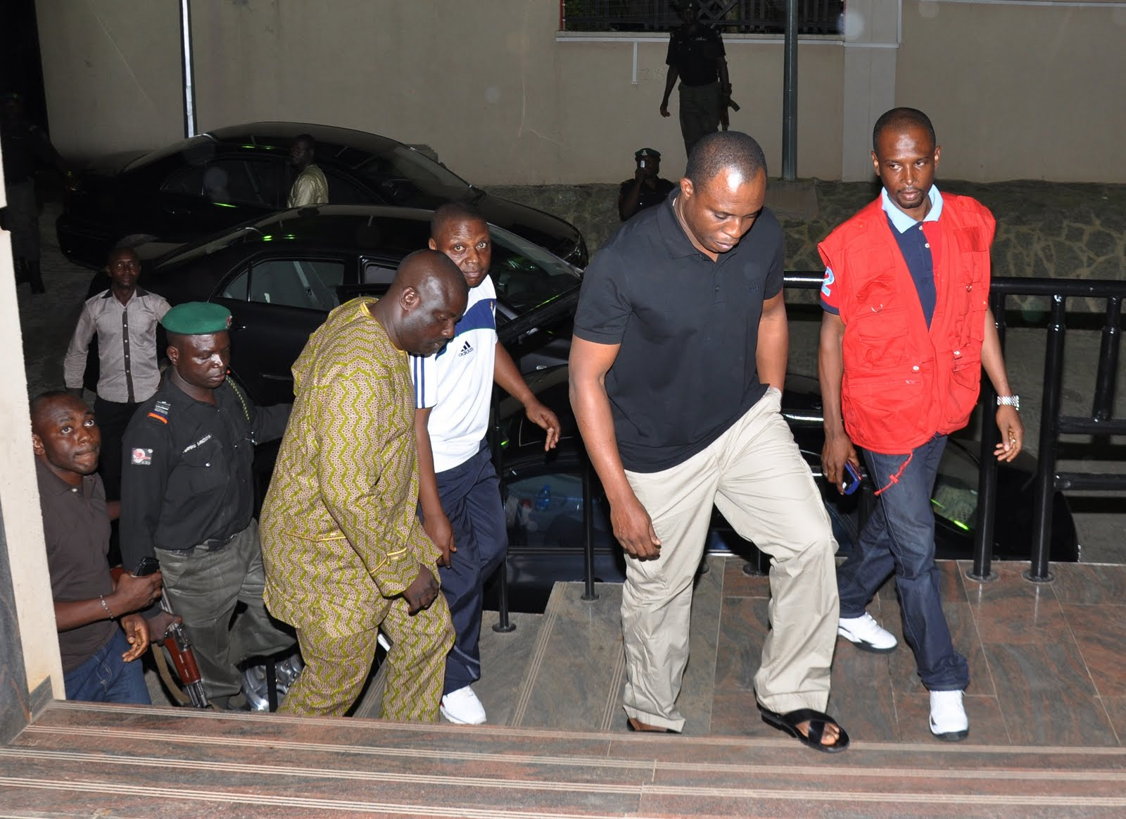 Dimeji Bankole, Fmr Speaker, House of Reps flanked by operatives of the EFCC on arrival at the EFCC HQTRS, shortly after he was