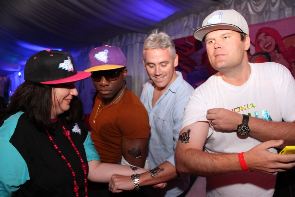 Deborah Shepard, Nick Imudia, Chris Brown and Teemu all of Nokia, showing off the Nokia Don't Break Da Beat Tattoo