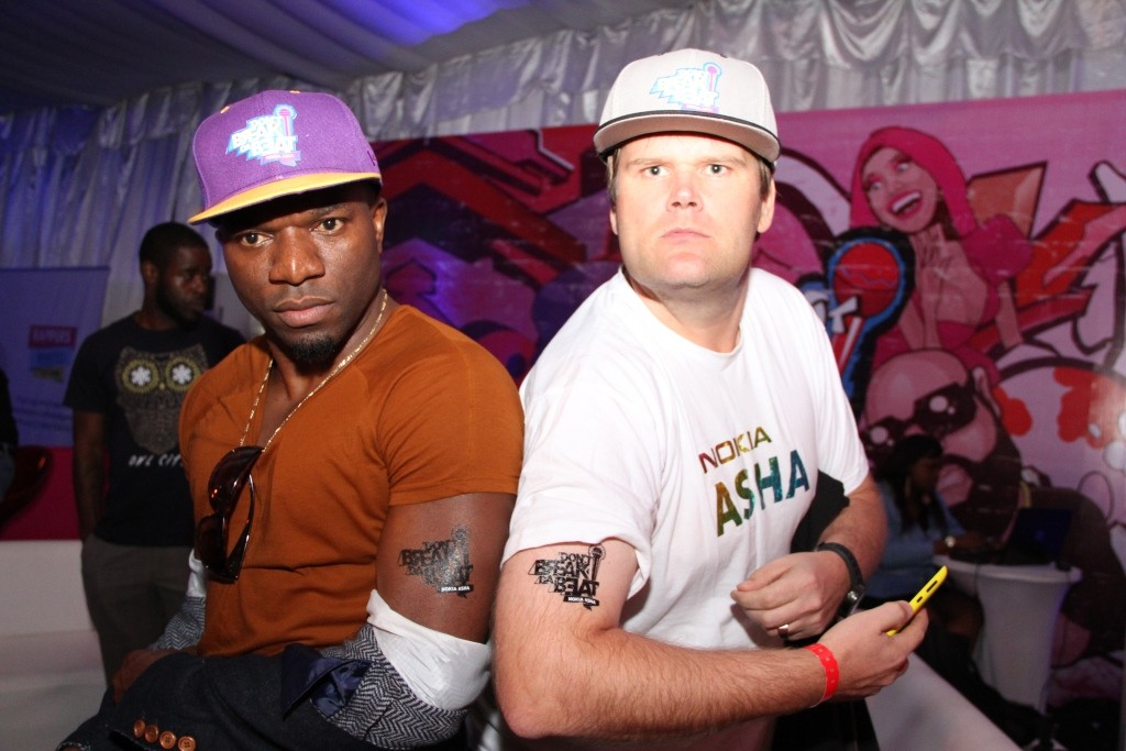 Nokia MD, Nick Imudia and Teemu Kiijarvi showing off the Nokia Don't Break Da Beat Tattoo