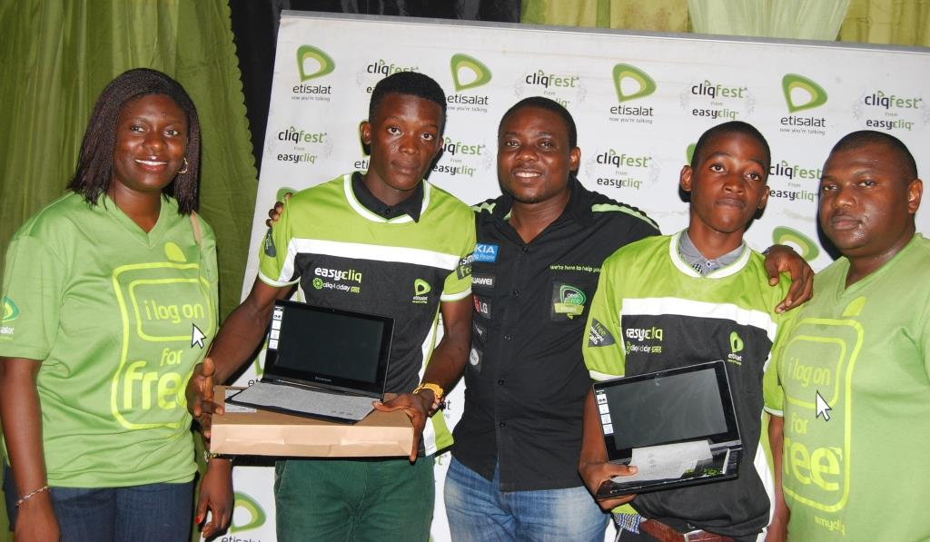 L-R: Manager, Sponsorships, Etisalat Nigeria, Orah Egwu; Winner of Etisalat branded laptop, Odunmbaku Gideon; Analyst, Youth Segment, Etisalat Nigeria, Michael Nwoseh; Winner of Etisalat branded laptop, Balogun Rilwan; and Manager, Youth Segment, Etisalat Nigeria, Idiareno Atimomo during the presentation of gifts at the 43rd edition of Etisalat Cliqfest, at the Tai Solarin University of Education, Ijebu Ode, Ogun State on Thursday, May 8, 2014