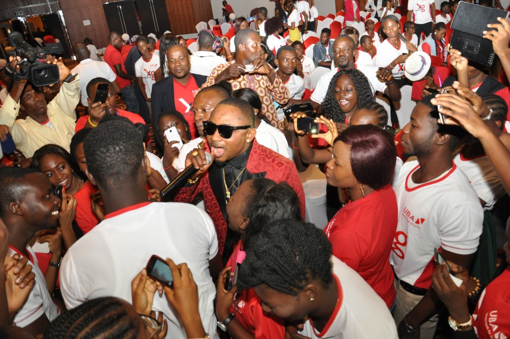 "Young Music sensation Sean Tizzle dazzling UBA's new generation of loyal customers at the product Launch of UBA's ""Next-Gen"" account in Lagos today."