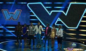 All contestants on stage with Uti Nwachukwu, Host
