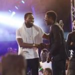 WATCH! The Moment D'Banj Signed An Upcoming Artiste On Stage In Warri