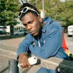 Burna Boy Gets Attacked By Fan, Apologizes In Return