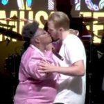 Teni Shocks Every One As She Kisses Fan Passionately On Stage, Puts His Hands On Her Bum || Watch